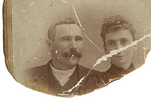 A severely damaged cabinet card photo in need of restoration